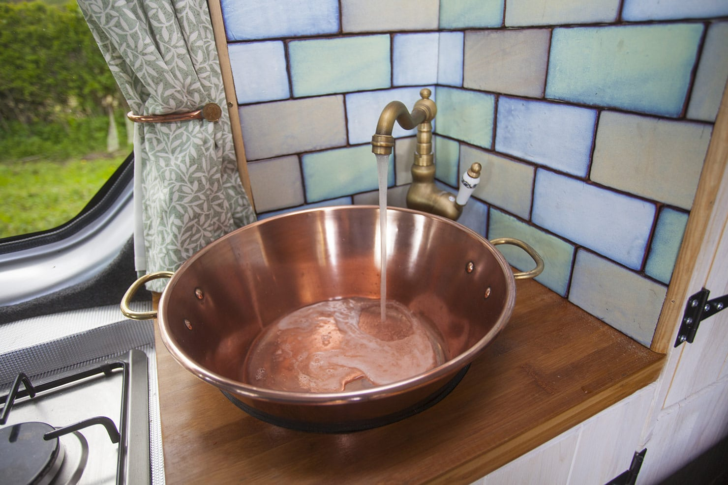 Running water on tap, want it hot? lift out the sink and heat on the hob... simple! :)