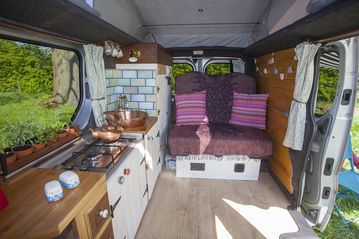 The spacious interior with Rock and Roll bed used as a bench seat and front seats rotated.