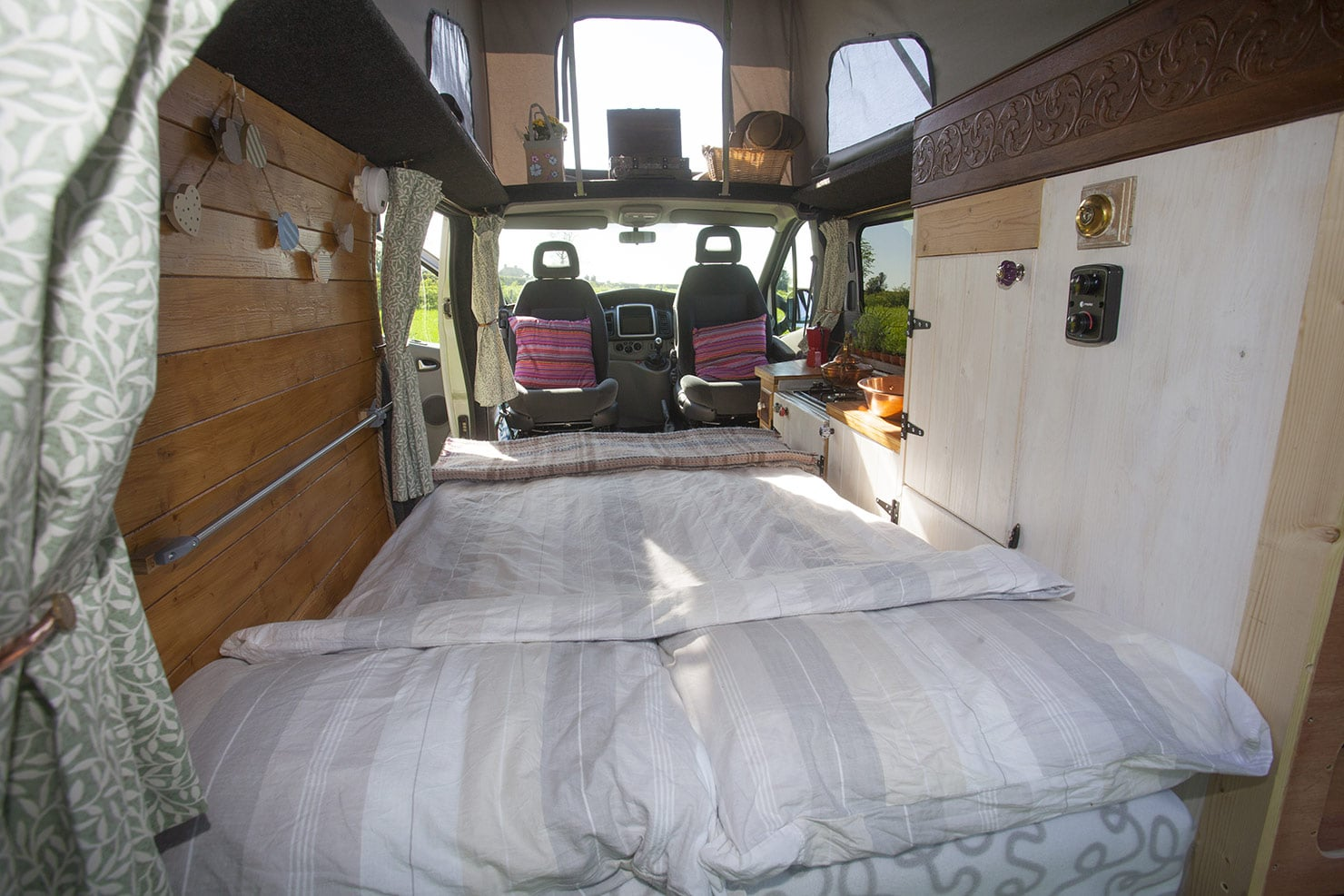 The Seat converted into a 6 foot bed, Ideal for a couple. (Showing optional bedding).
