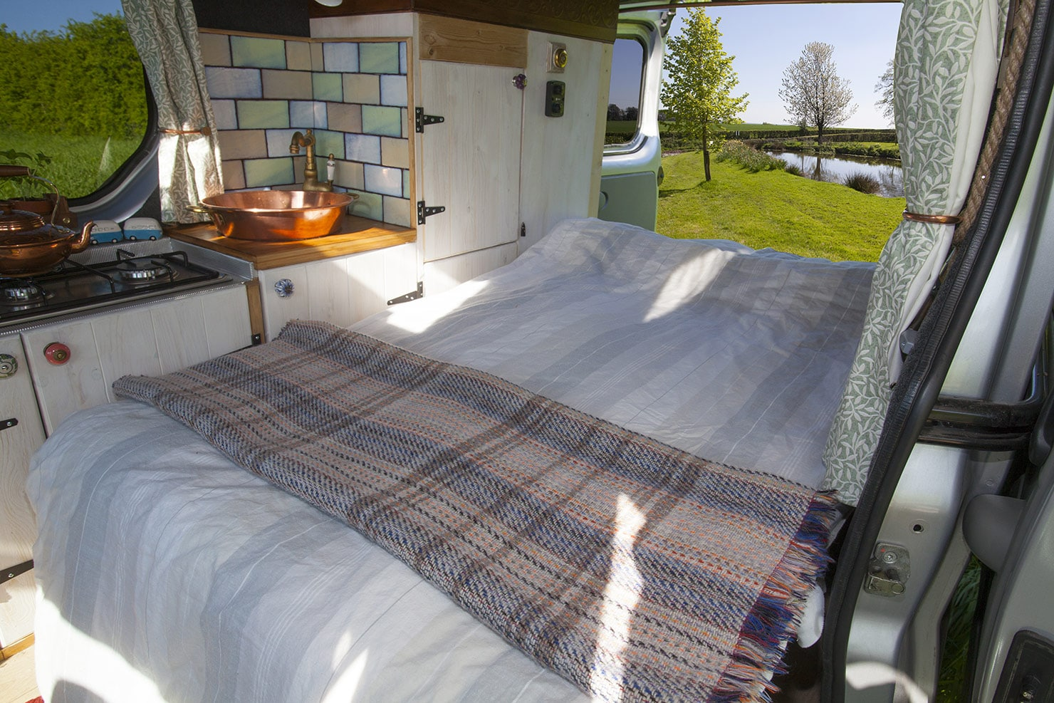 Easy to pull out, the bed gives plenty of room for two in this cosy campervan