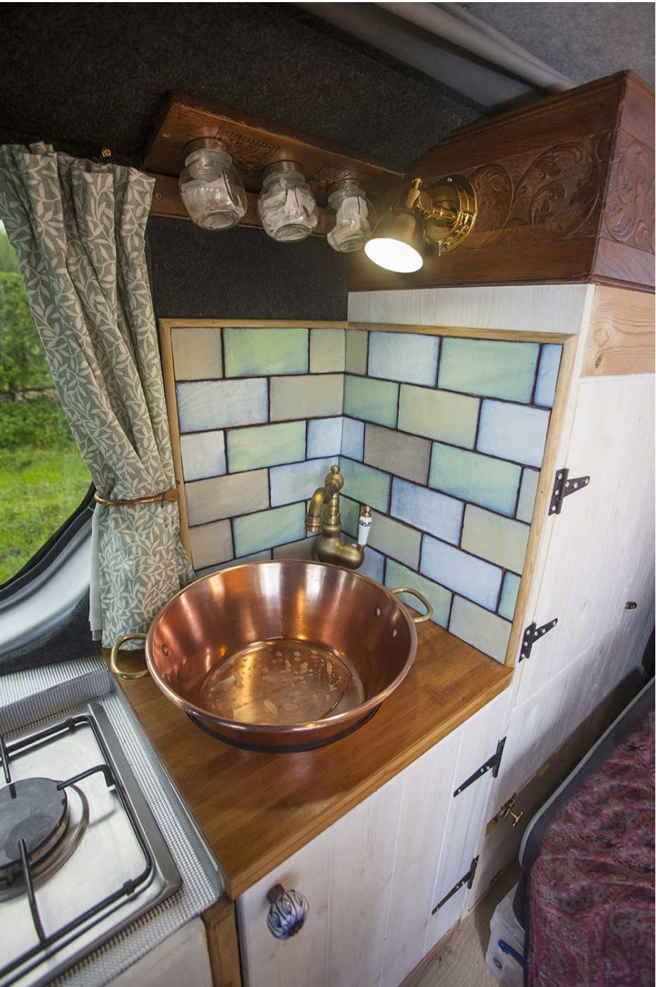 The quirky victorian Jam pan sink, with rustic tiling and brass light fittings.